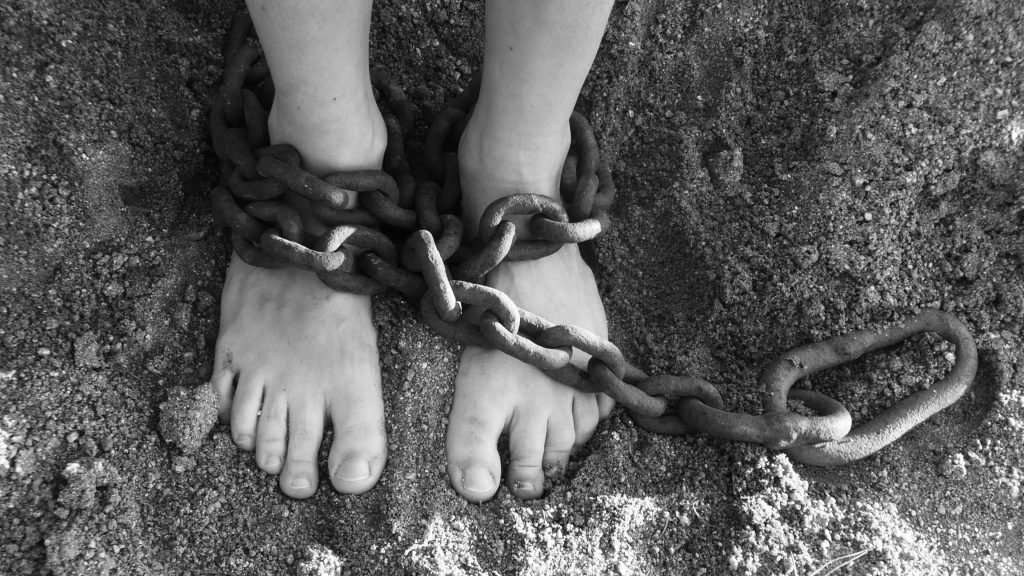victim of human trafficking in chains